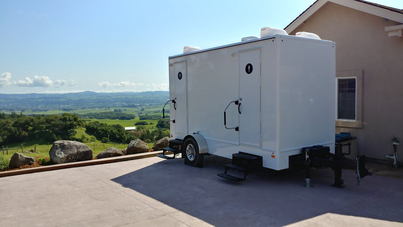 Our 4 stall flushing restroom trailer rental overlooks a valley in Sonoma County, CA