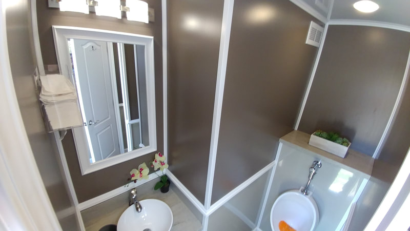 The interior of our 4 stall restroom trailer rental is delivered stocked and ready for your guests.