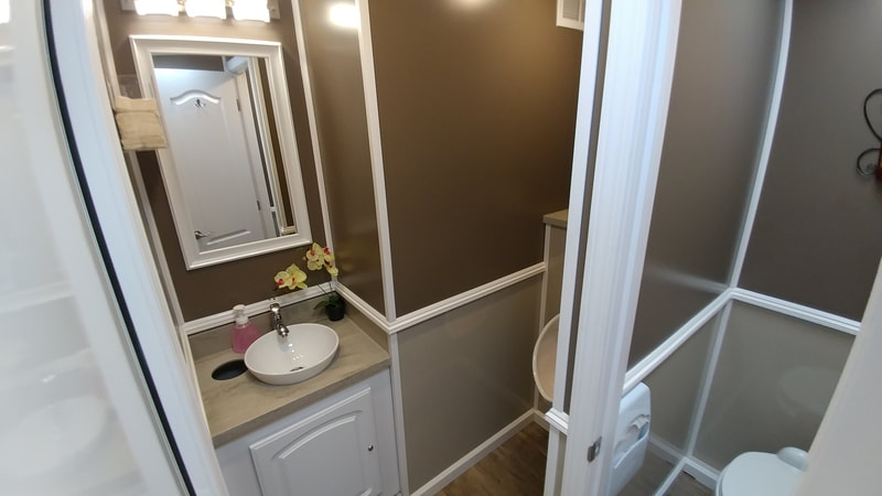 The interior of the mens suite of our 4 stall luxury restroom trailer rentals.