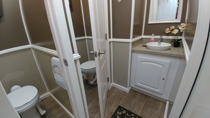The womens suite of our 4 stall portable restroom rental allows your guests privacy and air conditioned comfort.