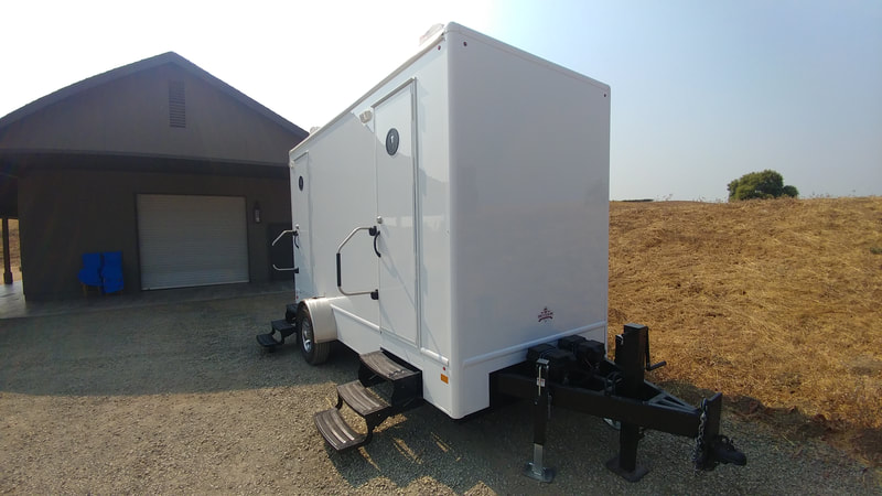 Our 4 stall portable flushing restroom rental awaits guests at a corporate vineyard event in Napa, CA.
