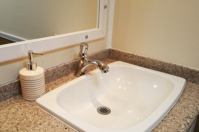 The Porcelain hand wash sink of our 3 Stall Portable Luxury Restroom Trailer Rental looks just like your bathroom sink at home.