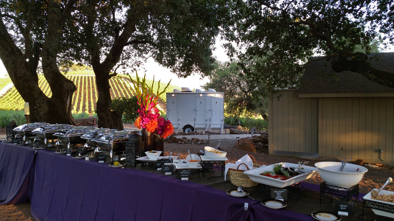 Our 3 Stall Portable Luxury Restroom Trailer Rental awaits guests during a dinner reception in Sonoma Counties wine country.
