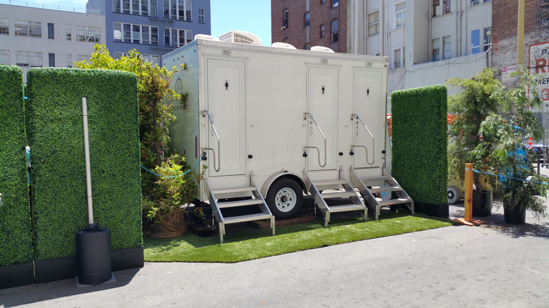 Our 3 Stall Portable Luxury Restroom Trailer Rental delights guests at a corporate sales expo in San Francisco, CA.